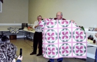 Auctioning off one of the ladies quilts at the annual Harvest Festival